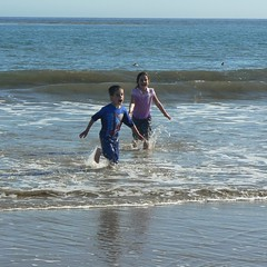 Playing in the waves at Refugio State Beach