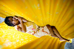 solar sleep (phitar) Tags: baby india flower yellow solar topf50 sleep hammock hampi abigfave