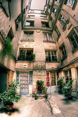 Apartment building court, Paris (The Other Martin Tenbones) Tags: paris france building court apartment fisheye 6e canettes supershot 400d p1f1