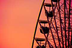 Ferris wheel (manganite) Tags: sunset red people sun men topf25 colors digital germany children geotagged dawn lights evening interestingness construction topf50 nikon women colorful europe bonn searchthebest tl steel silhouettes explore event seats ferriswheel onecolor d200 nikkor dslr funfair kirmes rheinaue jahrmarkt northrhinewestphalia interestingness52 supershot thecolorred i500 18200mmf3556 utatafeature manganite nikonstunninggallery 25faves ipernity challengeyou challengeyouwinner superaplus aplusphoto diamondclassphotographer flickrdiamond date:year=2007 rheininflamen geo:lat=50709891 geo:lon=7144986 date:month=may date:day=5 stadtgetty2010