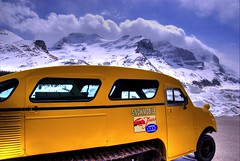 Historic Snowcoach, Columbia Icefield (Thad Roan - Bridgepix) Tags: blue sky mountain snow canada bus ice yellow clouds landscape nationalpark scenery rocks jasper tour antique historic glacier alberta hdr snowmobile icefield columbiaicefield 200705 snowcoach