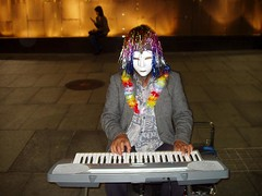 Black Lodge player. (mr walker) Tags: flowers woman white playing fountain silhouette keyboard phone mask sydney australia lei plastic twinpeaks wig tribute busker reggae homage martinplace cheesey davidlynch subconscious lloydreesfountain theowlsarenotwhattheyseem thisisnotanewspaperarticle