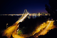 First visions of the Bay Bridge (Zeb Andrews) Tags: sanfrancisco california longexposure sunset film dusk cities cityscapes bridges slide nighttime baybridge bayarea lighttrails nikonfm2 fujivelvia bluemooncamera zebandrews zebandrewsphotography