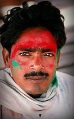 Face of Holi. India (fredcan) Tags: travel portrait india man festival asia colours indian handsome varanasi krishna hindu hinduism holi uttarpradesh indianportraits
