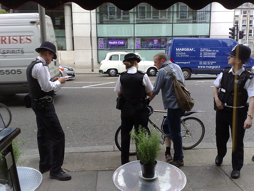 Police officers ticketing a dangerous red light jumper in Holborn