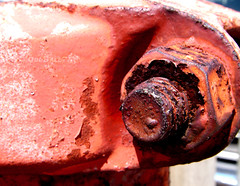 Red Rust (OddBall7) Tags: old red macro metal closeup photoshop ball cool rust paint pentax bad may 7 odd seven optio w10 2007 supershot oddball7