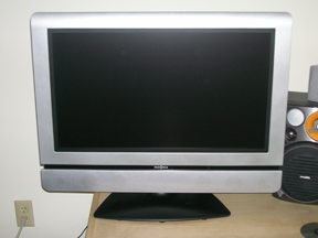 """27"""" LCD Flat Screen TV & Surround Sound System"""