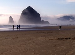 Haystack Rock (pete4ducks) Tags: blue brown seascape beach fog oregon landscape outdoors sand pacificocean pete oregoncoast 500views cannonbeach haystackrock 2007 interestingness167 i500 p1f1 pete4ducks peteliedtke explore14jun07 astunningmoment