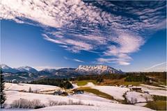 Winter coolly drifting in (Singflow) Tags: winter snow sky blue green meadow mountain singflow cloud cirrus landscape