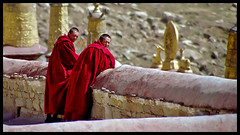 Lhasa, Drepung Monastery, 2 monks on the rooftop (Lasse skovgaard) Tags: tibet monks lhasa drepungmonastery flickrchallengewinner takingonfilmandthenscanned lasseskovgaard