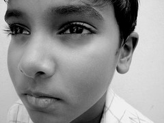 Tell me (Ashwa Faheem ( avva )) Tags: light boy portrait kid eyes child emotive abigfave