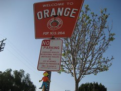 "Flat Stanley poses with the ""Welcome to Orange"" sign. (04/07)"