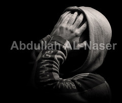 Traumatic Exposure (Abdullah AL-Naser) Tags: portrait white selfportrait black reflection umbrella self canon dark studio sadness interesting sad darkness blind flash creative dramatic problem human shock drama problems f28 trauma kuwaiti strobe blindness selfshot q8 30d 70200mm traumatic abdullah abraj speedlite ef70200mm ef70200  f28l abraaj  strobing superaplus aplusphoto 58ex digidarkroom