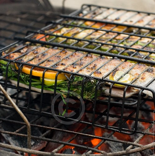 Whole trout on the grill with asparagus