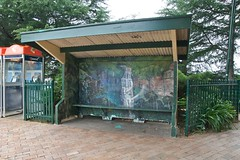 the bus stop (yewenyi) Tags: art painting mural geocaching australia bluemountains busstop telstra nsw newsouthwales publicart shelter aus wallpainting phonebox lestweforget oceania wentworthfalls auspctagged pc2782 gc10mab
