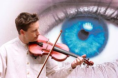 Cambridge buskers: V-eye-linist (Sir Cam) Tags: cambridge music eye streetperformers violin buskers pettycury opticalexpress