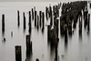 Make room for alien structures (Maerten Prins) Tags: america unitedstates amerika newyork manhattan longexposure 30seconds water hudson poles wood old decay bw
