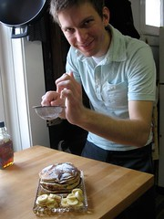 Nutty Pancakes- Chris dusting with powdered sugar (photo- Sujata)-2.jpg