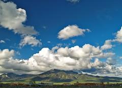 Taos Peak view (benrobertsabq) Tags: blue sky mountains newmexico green clouds landscape view rental sage taos nm polarizer mesa nuevomexico landofenchantment may2007
