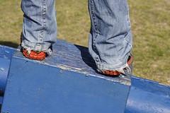 Tilt (EltonHarding) Tags: wood blue orange green grass angel see saw shoes raw play pants sneakers jeans denim puma tilt levis playful slope takkies img1732