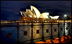 Sydney's Opera House (say.fromage) Tags: ocean city longexposure sea house reflection water night canon reflections office opera cityscape harbour sydney australia nighttime highrise operahouse sydneyharbour sydneyoperahouse 30d buiildings supershot instantfave 25faves diamondclassphotographer flickrdiamond