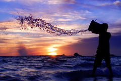 Sky Cleaner (muha...) Tags: life camera sunset sea sky water silhouette work children garbage bravo lifestyle wave windy clean wash maldives maldiveislands nikonstunninggallery abigfave anawesomeshot flickrdiamond
