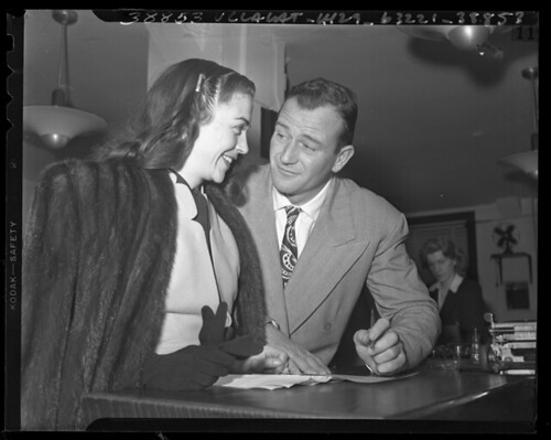 Photo Caption: Actors John Wayne and Mexican film actress Esperanza Baur