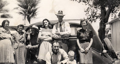 vintage: family gathering in front of old car,...
