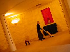 Vajrasana straw bale shrineroom being cleaned