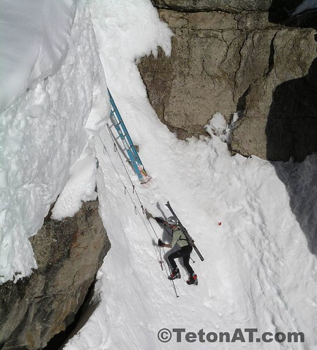Cary Smith reaches the ladder in Corbet's Couloir