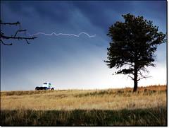 Streaking (wazzuvius) Tags: sky storm grass streak bolt lightning