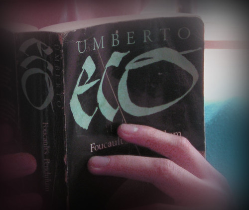 A person holding a book Umberto Eco.