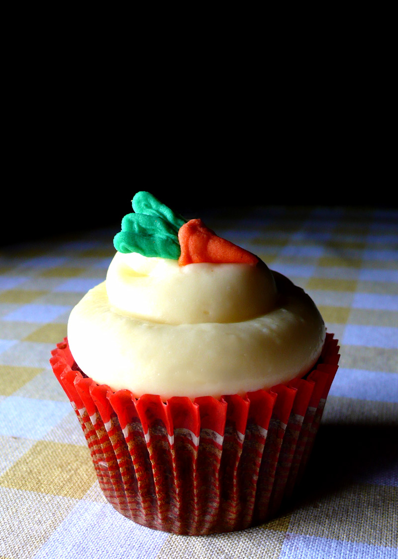 a carrot cupcake with a cream cheese frosting