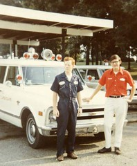 Jim Moshinskie, right, and Larry Russell, by Emerson & Son Funeral Home Chevrolet Suburban ambulances, Jonesboro, Arkansas, 1970, awaiting the next Code 3 run (Dr. Mo) Tags: pcs ambulance medicine bls ems emt funeralhome firstaid emergencymedicine staroflife ambulancedriver deathcare drmo moshinskie jimmoshinskie funeralhomeambulance funeralcustoms professionalcarsociety scenesafety