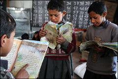 old books - Muzaffarabad, Pakistan (Maciej Dakowicz) Tags: 2005 school pakistan camp children student earthquake october asia destruction relief help aid doctor damage kashmir nwfp pupil ngo savethechildren balakot humanitarianism sungi