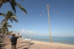 Indigenous Men Swinging from Pole (tomdos) Tags: springbreak puertovallarta malecn