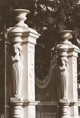 Detail: Gate, Roseland Park Cemetery--Berkley MI (pinehurst19475) Tags: sculpture detail slr monochrome cemetery sepia architecture gate michigan pillar entrance granite woodward filmcamera pillars berkely caryatids sepiatone caryatid woodwardavenue femalefigure metrodetroit architecturalelement sculpturalrelief cemeterygate roselandpark roselandparkcemetery woodwardsights berkelymichigan