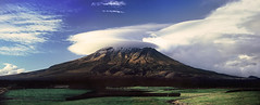 A Wide View Of The Mountain That Knows How To Hook The Passing Clouds (Peter Kurdulija) Tags: park new shadow panorama cloud snow film nature beauty composite fence landscape volcano nikon stream mt stitch wide sigma mount explore zealand national 5000 fujichrome lenticular taranaki egmont paddock blurb splendor f801 kurdulija