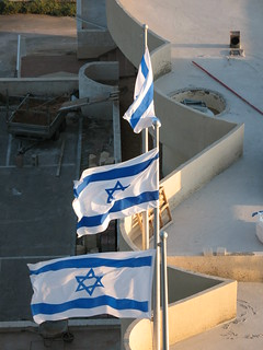 Israeli flags along the separation wall.