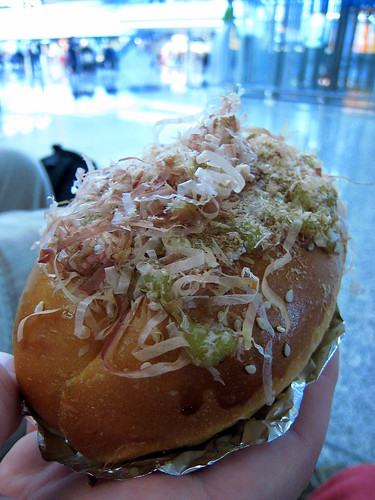 Tasty bun with pork filaments and mustard