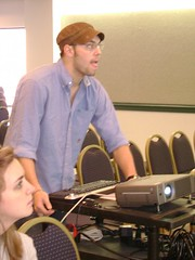 "Session 1B, ""What's Black & White and Read All Over?"" Presenter Gregory C. Magee deals with pre-session equipment problems. 2007 University Writing and Research Symposium. The George Washington University. Saturday, April 21."