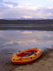 rubber raft on the shore of Radoniq Reservoir (kosova cajun) Tags: lake mountains reflection clouds landscape scenery reservoir kosova kosovo snowcappedpeaks peisazh gjeravica radoniq rubberraft liqeniiradoniqit rasaezogut bazeniiradoniqit