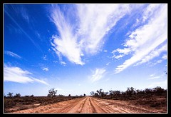 Wide Open Road (Threepwood) Tags: road travel blue wild summer vacation sky cloud brown white holiday hot travelling dusty nature clouds easter landscape sand rocks solitude track day driving desert wind path bare australia victoria dirt outback lonely waste wilderness solitary desolate barren murray uninhabited scrub arid isolated thirsty mildura blown converge parched wilds badland waterless uncultivated infertile aridregion unproductive murraysunsetnationalpark superaplus aplusphoto superhearts moistureless projectblue untilled