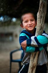 Posing for the photo (Luis Montemayor) Tags: portrait food smile mexico kid bokeh retrato comida sonrisa nio realdecatorce sanluispotosi chimuelo dflickr dflickr180307