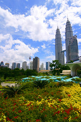 kuala lumpur skyline (lucanicae) Tags: city urban green topv111 skyline clouds digital canon geotagged eos rebel petronas towers malaysia 100views 200views kuala lumpur globalvillage xti 400d aplusphoto lunarvillage heartawards