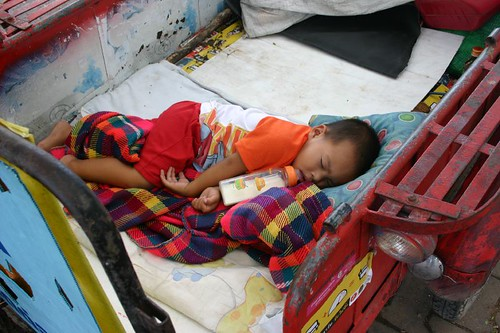 Sleepy child in Lop Buri.