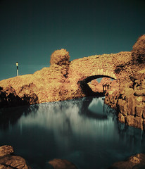 Blackpool RockGarden bridge (CowGummy) Tags: longexposure ir infrared rockgarden blackpool falsecolour hoyar72 abigfave canon400d cowgummy