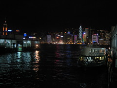 Hong Kong at night - city skyline across the harbor - taken from the Star Ferry ramp
