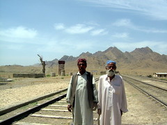 Galungur Station (Commoner28th) Tags: old railroad pakistan light sunset people mountain afghanistan mountains travelling heritage history tourism station century train vintage children wonder landscape amazing track shadows desert iran time great culture railway tunnel visit scene tribal line hills british passenger khan legend ahmed bolan chaman durand kandahar csa pathan waitting agha railwaymen quetta waseem pakistanrailway commoner sibi pashtun baluchistan awwed galangur shelabagh kommoner commoner28th