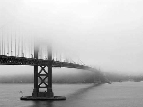 golden gate bridge fog. Golden Gate bridge against fog